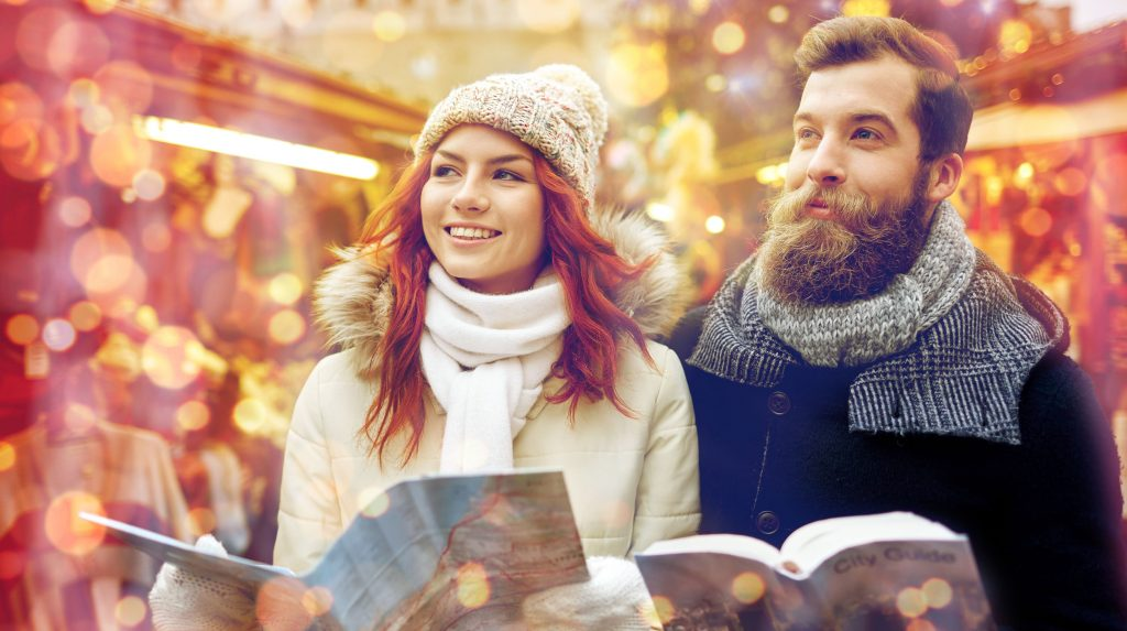 64886896 - holidays, winter, christmas, tourism and people concept - happy couple in warm clothes with map and city guide in old town